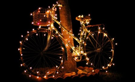 a bike with fairy lights on